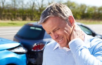 man with pain neck after car collision