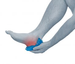 person puting a compress on a painful heel