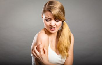 Woman Grabbing Her Arm in Pain