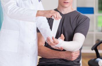 Man Getting an Arm Cast